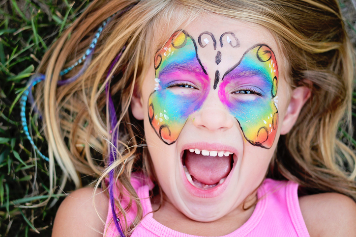 Little GIrl Smiling Face Painted GettyImages 182089413